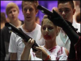 "Visitor plays ""Dangerous Animals"" during the Gamescom 2012 fair in Cologne"